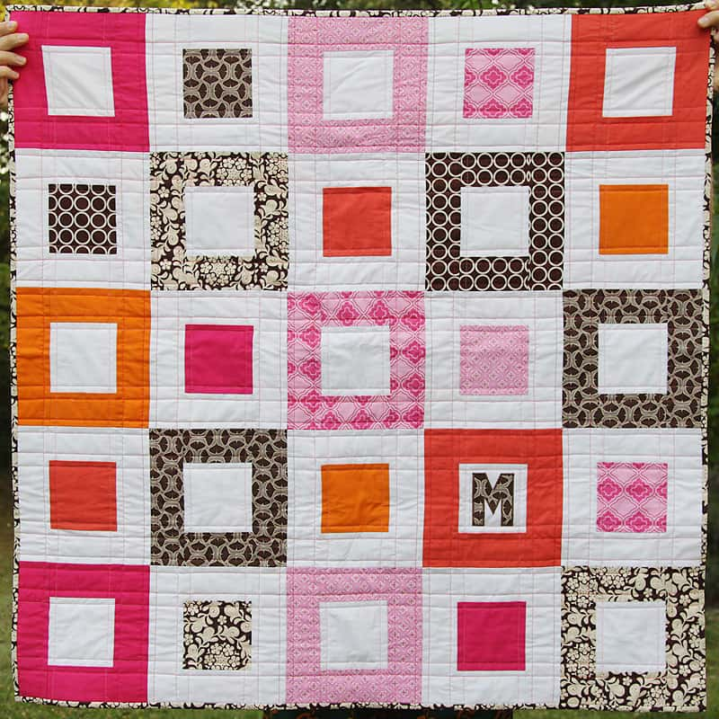 A simple log cabin baby quilt by Kirsty at Bonjour Quilts