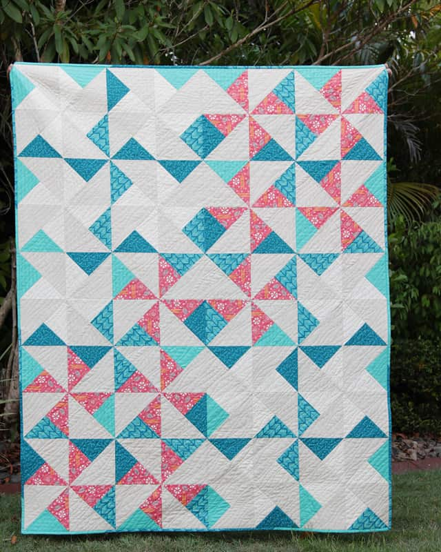 Pinwheel Puzzle quilt by Bonjour Quilts