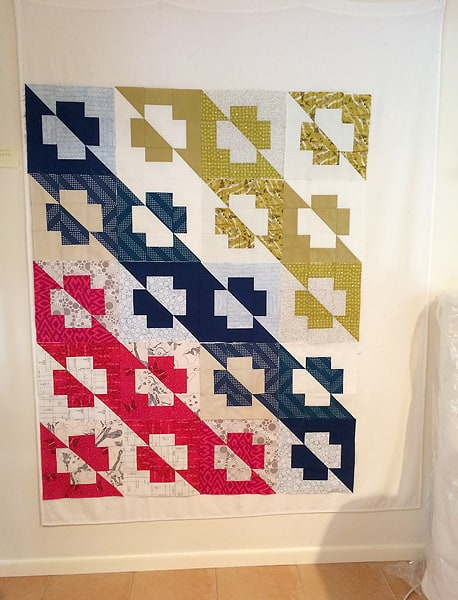 The Plus Side quilt pattern by Bonjour Quilts. An easy modern quilt suitable for beginners; pattern available for sale.