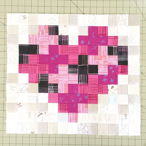 A heart shaped patchwork block by Kirsty at Bonjour Quilts