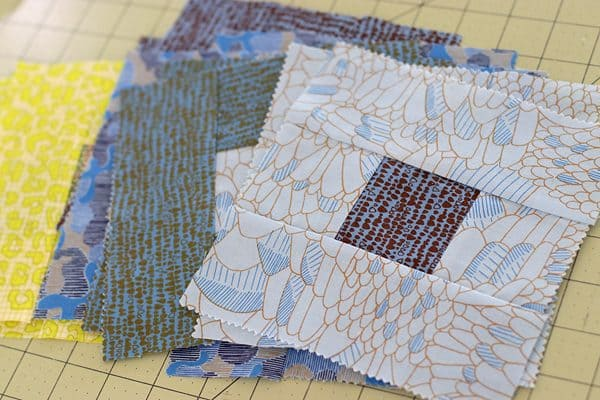 Gleaned fabric, log cabin quilt by Bonjour Quilts