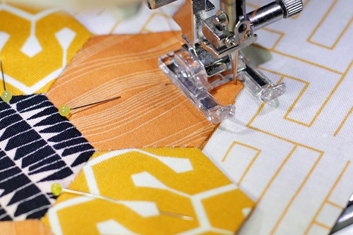 Then lift your sewing foot and pivot the piece until your foot is in line with the next edge.