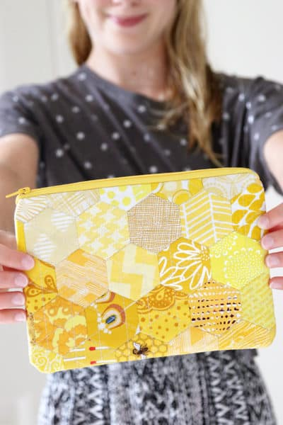 Use English Paper Piecing to sew a beautiful hexagon zipper pouch, as per Carolina Moore's Learn to English Paper Piece book.