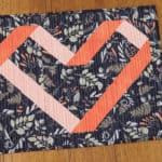 Using coral fabrics, a la Pantone Colour of the Year 2019 Living Coral, to create a cute Ribbon Heart mini quilt