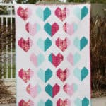 A heart quilt pattern that comes in 4 sizes, called the Heartfelt Quilt pattern