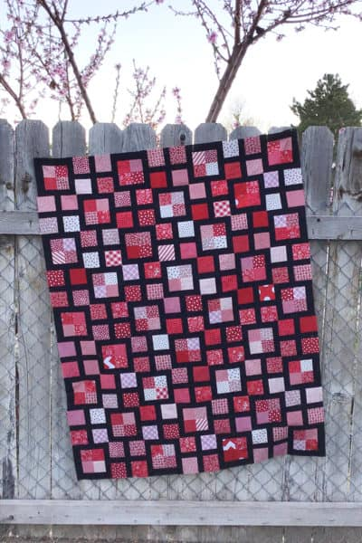 Red and black Scrappy Lattice quilt sewn by Kalynn