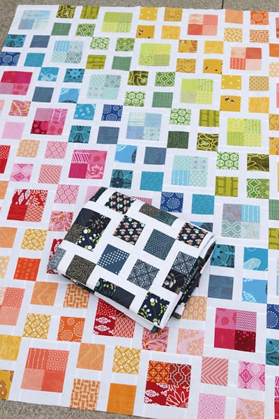 scrappy rainbow quilt by Bonjour Quilts