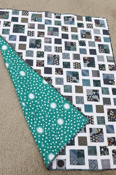 Scrappy Lattice quilt pattern with a teal backing