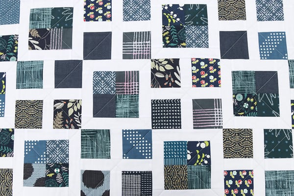 Navy scrap quilt with white sashing