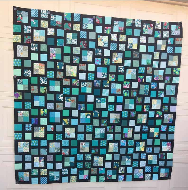 Teal and black Scrappy Lattice Quilt sewn by Cynthia @praterclp