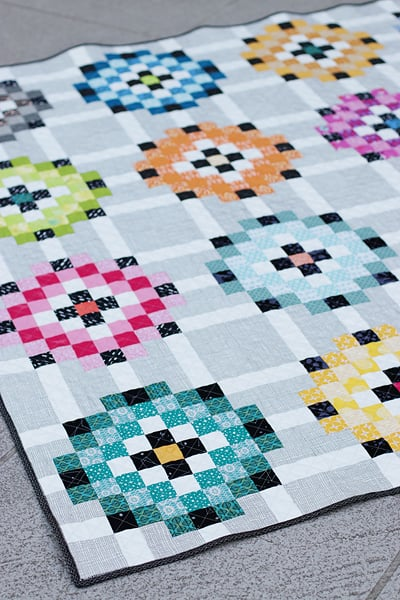 A colourful patchwork scrap quilt called Scrap Magnet