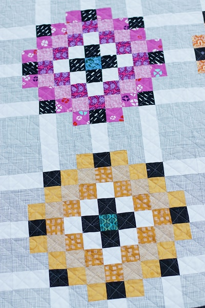 Individual blocks in a Scrap Magnet quilt.