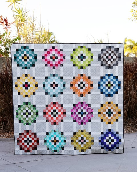 Scrap Magnet quilt pattern. A 16 block throw sized quilt.