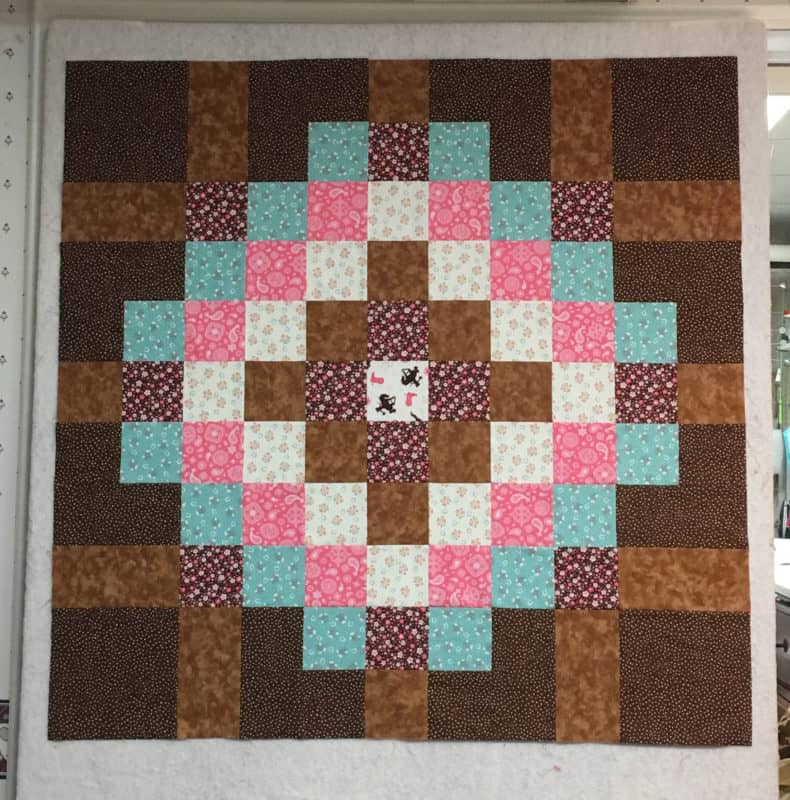 A large scrappy patchwork block