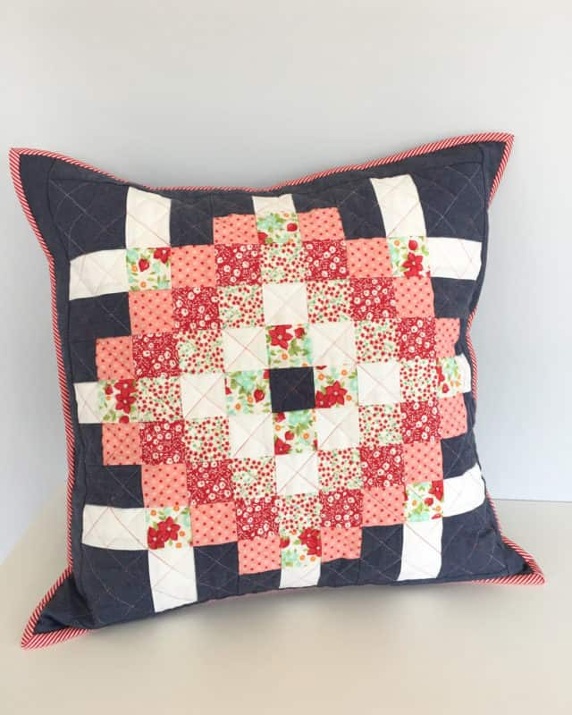 A quilted cushion sewn from scraps.