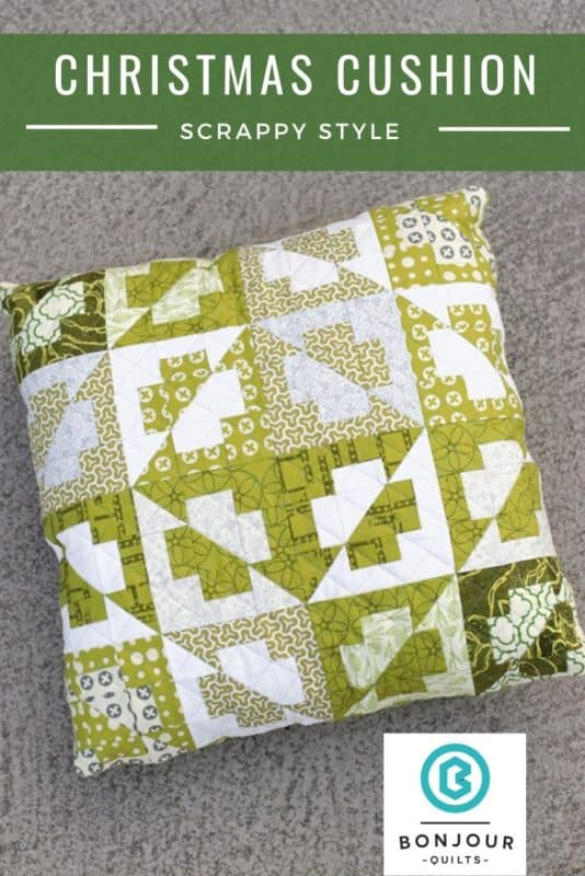 A scrappy green Christmas cushion, sewn from the Plus Side quilt pattern by Bonjour Quilts. Layer cake friendly in the mini/cushion size.