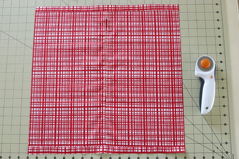 Red fabric backing for a Christmas cushion made with the Scrap Magnet  quilt pattern.