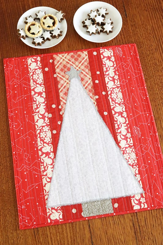 Candy Christmas mini quilt pattern by Bonjour Quilts. An easy appliqué Christmas decor item.