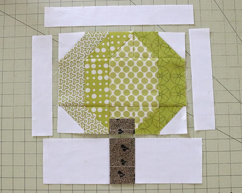 Sewing together the patchwork pieces to form a Tree Quilt Block.