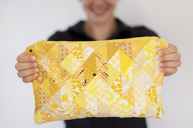 Yellow zipper pouch made from scrap fabric