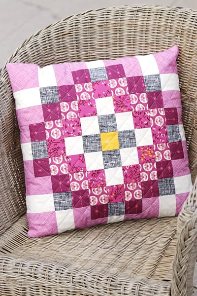 Scrappy purple cushion