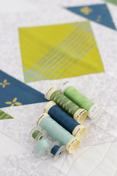 Quilting threads to match a flying geese quilt