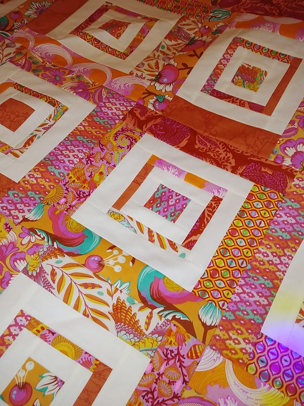 Leigh's beautiful version of Bonjour Quilts' Diamonds in the Deep quilt pattern made with a mix of Tula Pink prints.