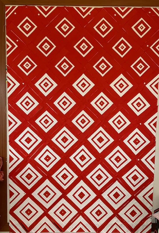 Leanne's beautiful version of Bonjour Quilts' Diamonds in the Deep quilt pattern made in red and white. It's a stunner!