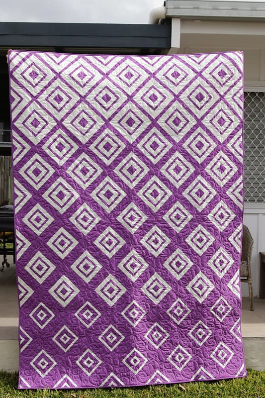 Modern Log Cabin quilt in purple and white
