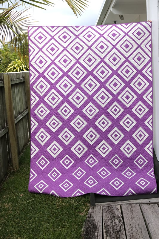 Purple and white log cabin quilt pattern