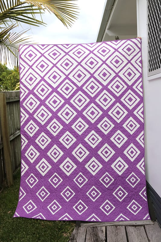 Purple and white Diamonds in the Deep quilt