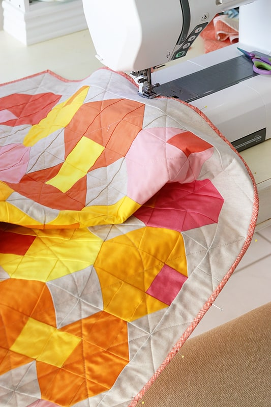 attaching a binding to a quilt with a sewing machine