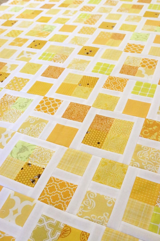 scrappy yellow fabric quilt pattern