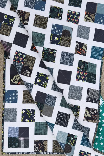 Scrappy blue and white quilt