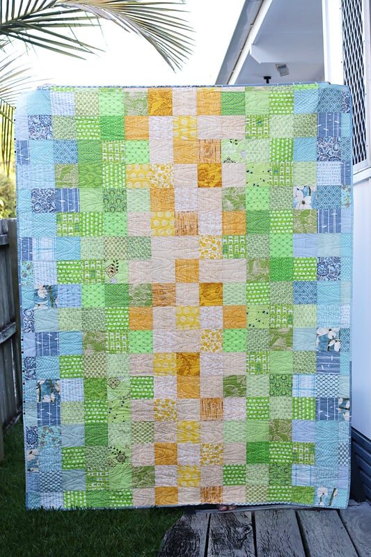 A scrappy quilt backing for a twin quilt