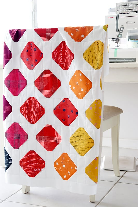 A modern baby quilt pattern with colourful lolly shaped blocks
